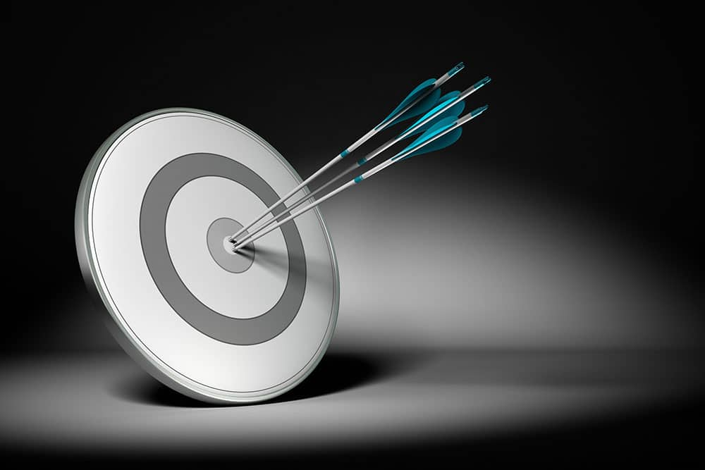 Target with multiple bullseye shots.